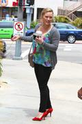 http://img208.imagevenue.com/loc507/th_708279488_Hilary_Duff_out_and_about_in_Studio_City33_122_507lo.jpg